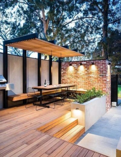 a-modern-deck-with-a-corner-floating-bench-a-dining-set-of-wood-and-metal-and-some-lights-475x594